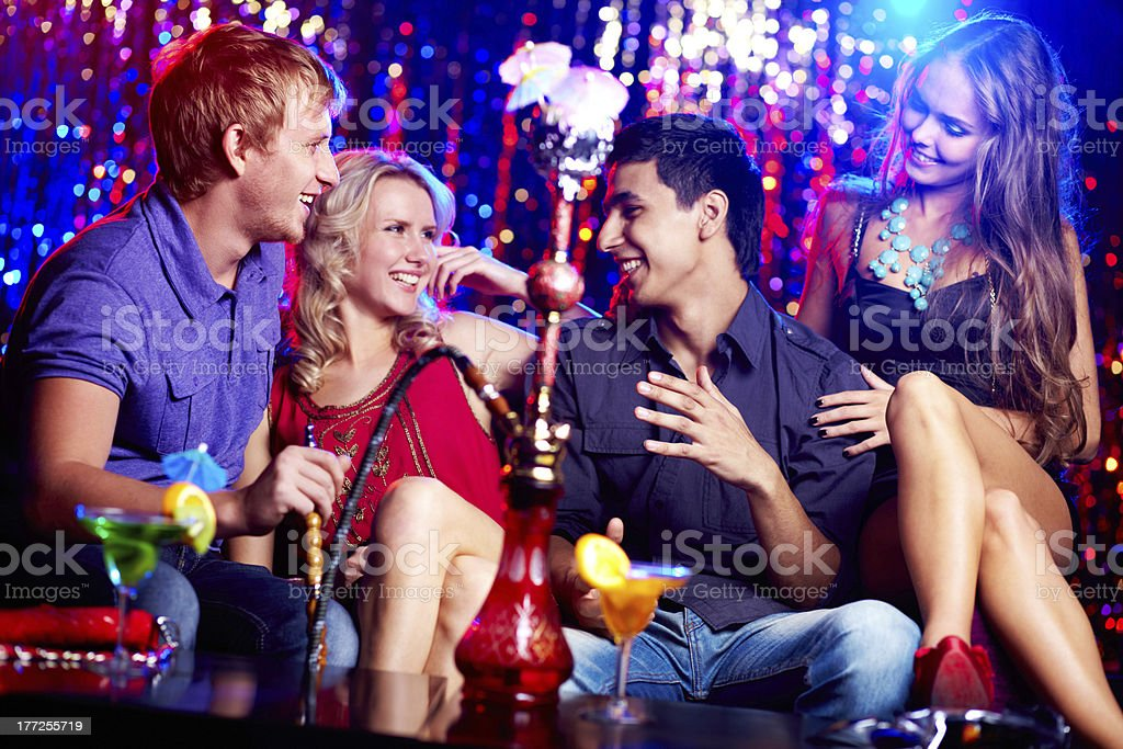 Friends in hookah room stock photo