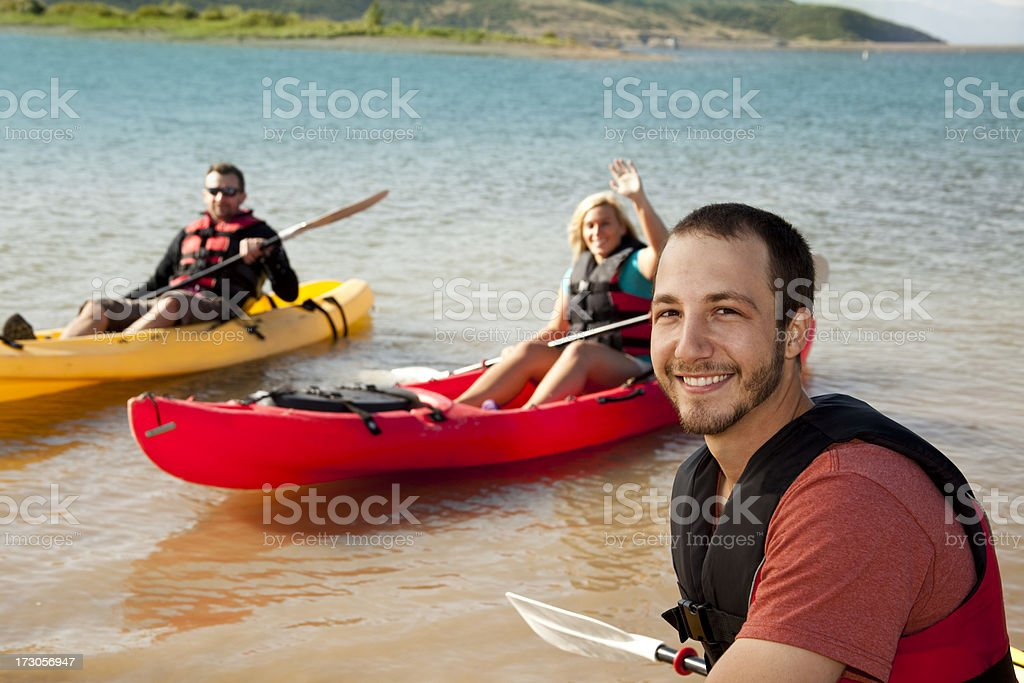 Friends in kayaks. Lake or ocean. Outdoor sport. Healthy lifestyle. royalty-free stock photo