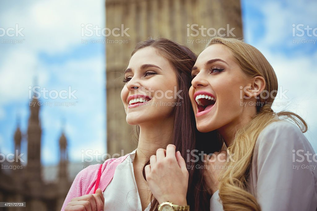 Friends in London Outdoor portrait of two happy young women with Houses of Parliament and Big Ben in the background. 20-24 Years Stock Photo