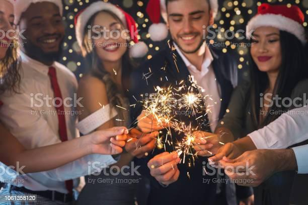 Friends in new year eve with sparkling bengal lights picture id1061358120?b=1&k=6&m=1061358120&s=612x612&h=cbh4yzjq 0bscgmgayz1x nfrfiflhrlwbcuq gj2ki=