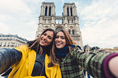 Young women on a vacation in France taking selfie