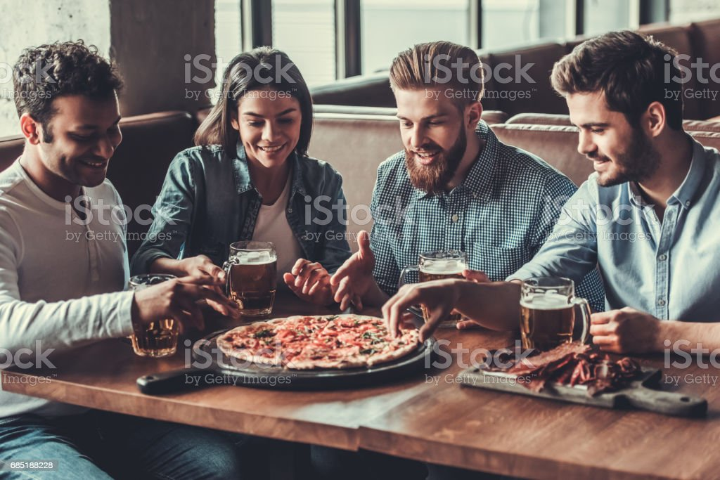 Friends in pub royalty-free stock photo