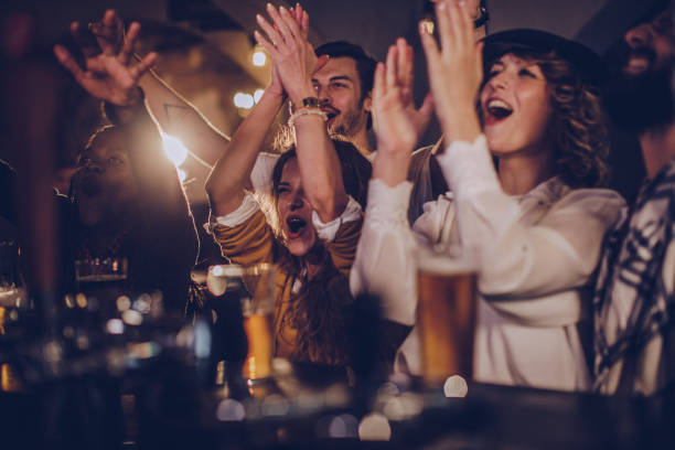 friends in pub watching match - sports stock pictures, royalty-free photos & images