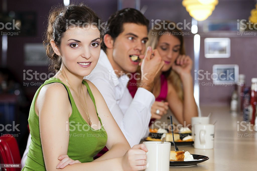 Friends in Restaurant eating and drinking royalty-free stock photo