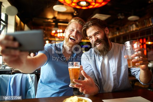 istock Friends in the bar posing for a selfie 1062727266