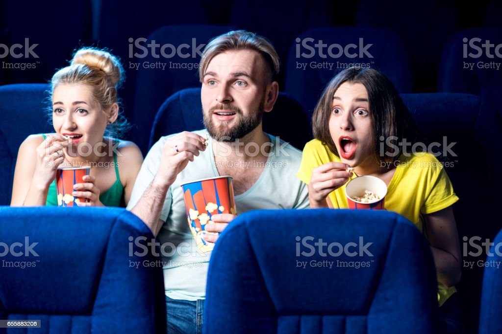 Friends in the cinema stock photo