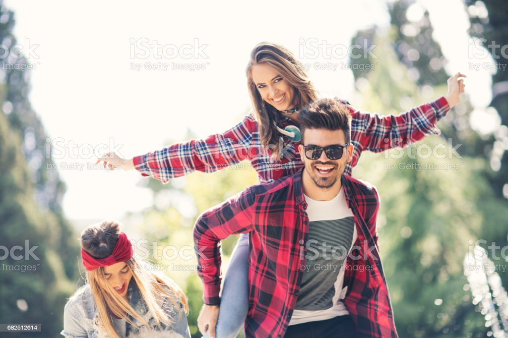 Friends in the park having fun royalty-free stock photo