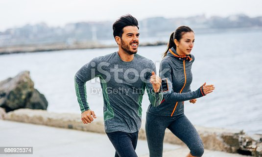 istock Friends jogging by the sea 686925374