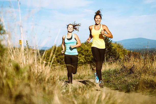 friends jogging in nature area - jogging hill bildbanksfoton och bilder