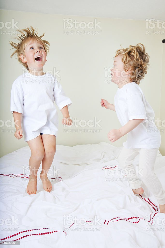 Friends jumping on the bed royalty-free stock photo