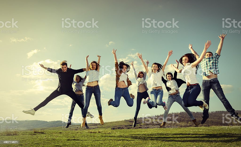 friends jumping stock photo