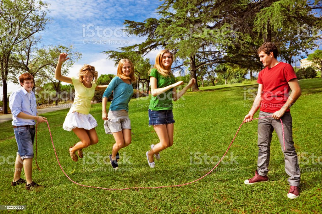 Friends jumping the rope royalty-free stock photo