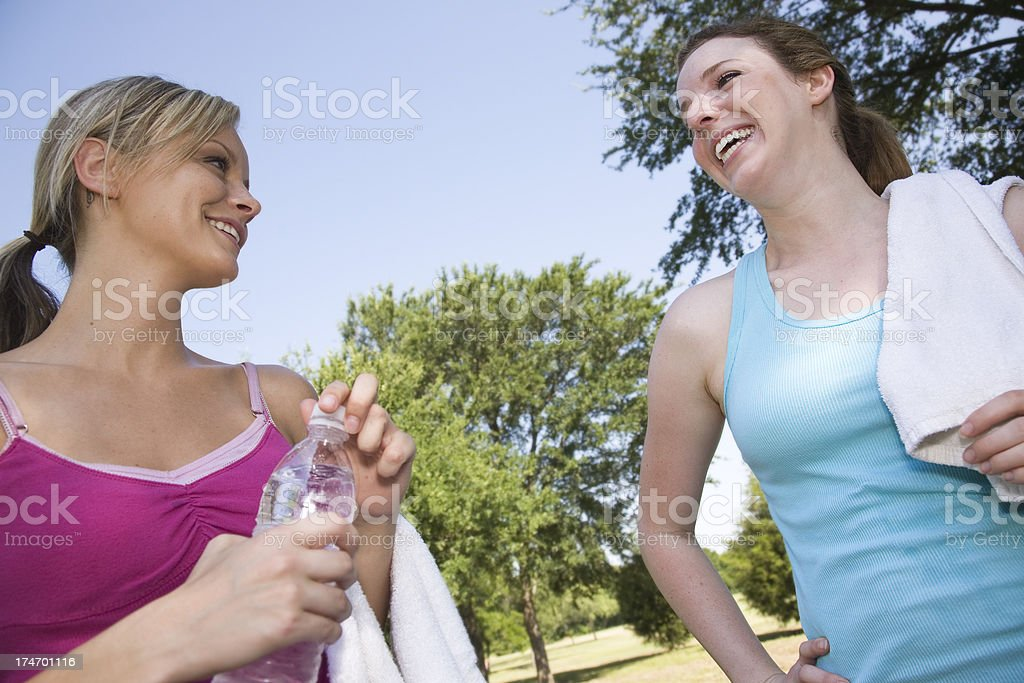 Friends Laughing and Talking After their Workout royalty-free stock photo