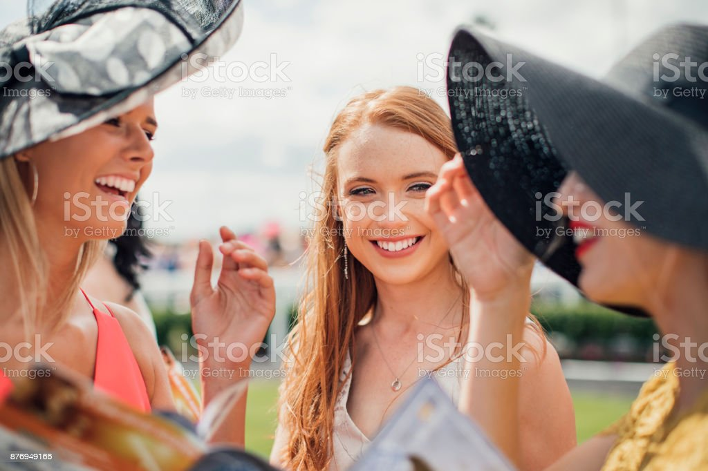 Friends Laughing at Ladies Day stock photo