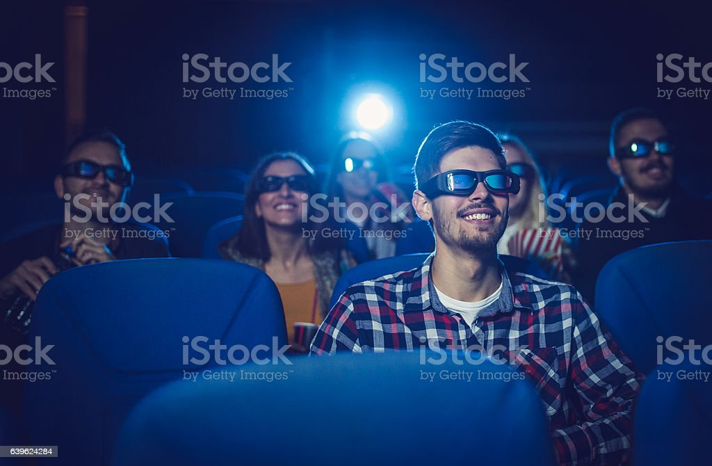 Friends laughing at the comedy movie - Photo