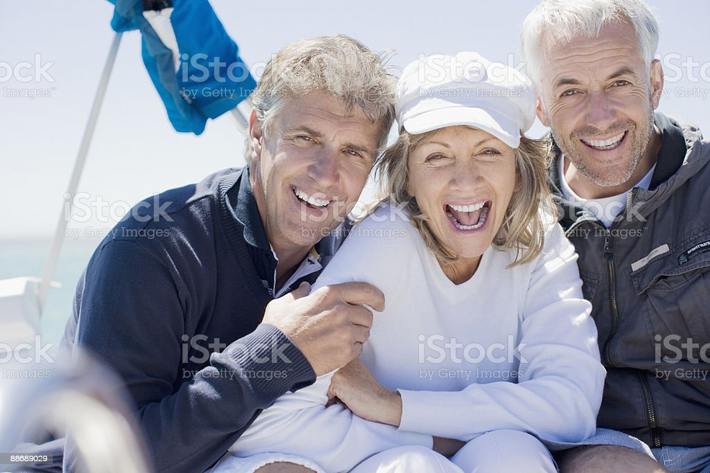 Friends laughing on sailboat royalty-free stock photo