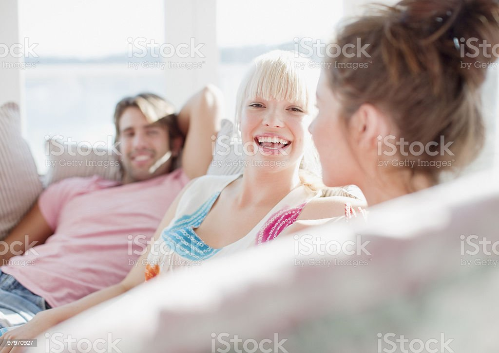 Friends laughing on sofa royalty-free stock photo