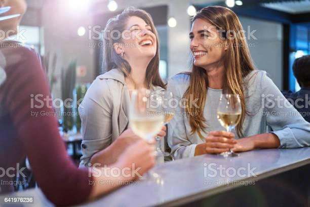 Friends laughing while enjoying drinks in bar picture id641976236?b=1&k=6&m=641976236&s=612x612&h=1d7e7b6qcnnatir755tgj8z9qzjdqzdsgtfv  b3lyi=