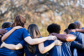 istock Friends linking arms in unity 1199706305
