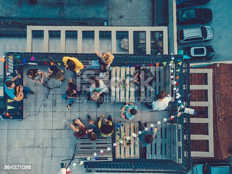 Group of friends enjoying a party on the rooftop