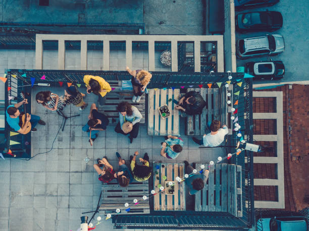 friends listening to a music band on the rooftop - urban lifestyle stock photos and pictures