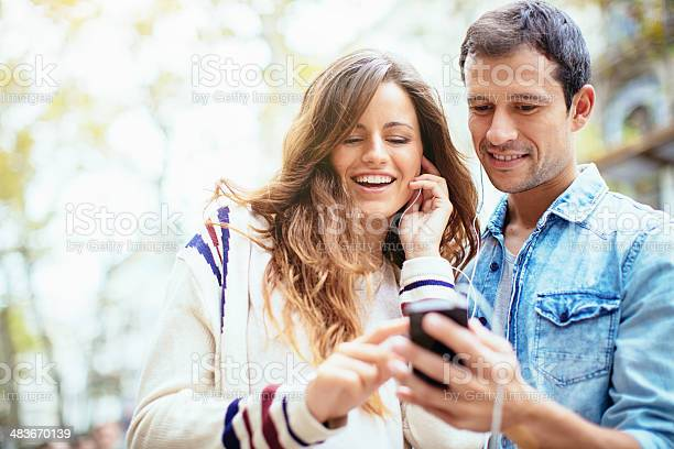 Friends Listening To Music Stock Photo - Download Image Now