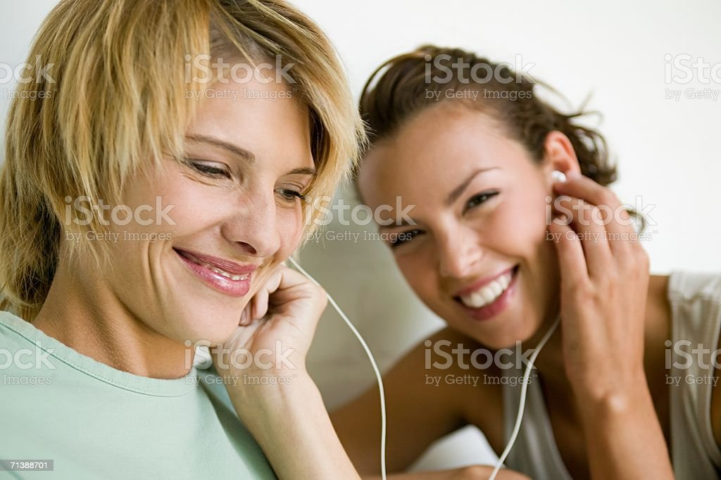 Friends listening to music royalty-free stock photo