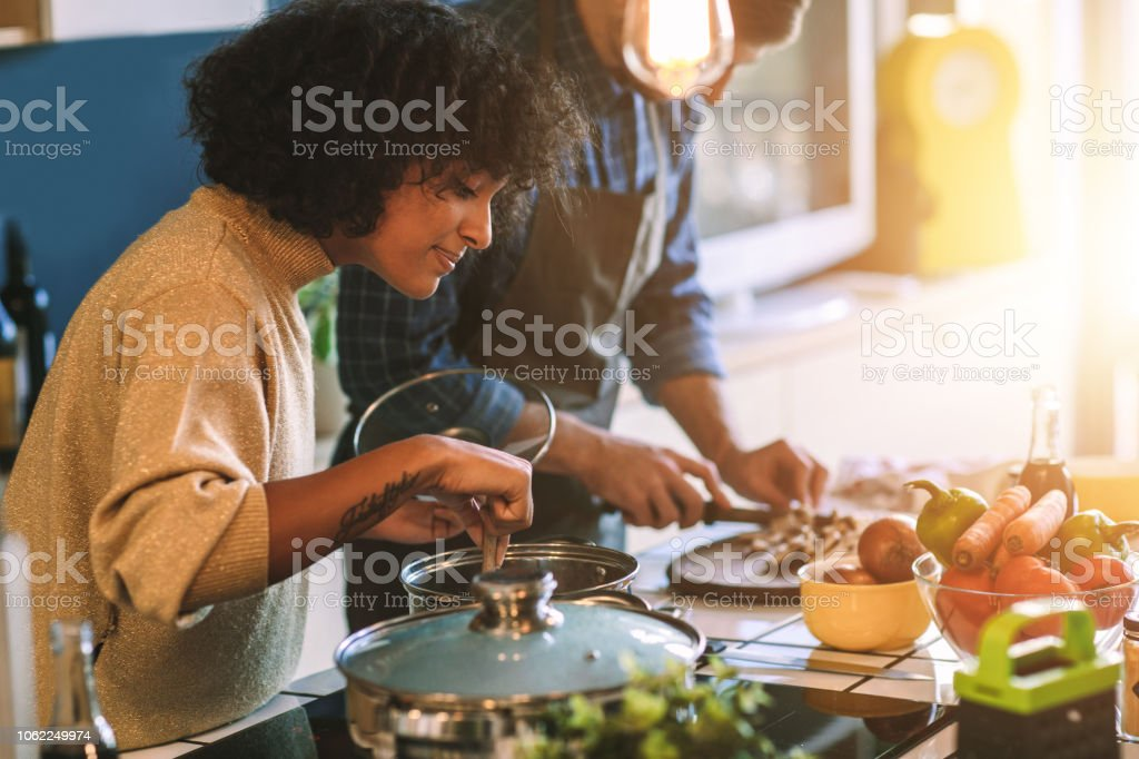 Friends Living And Cooking Together stock photo