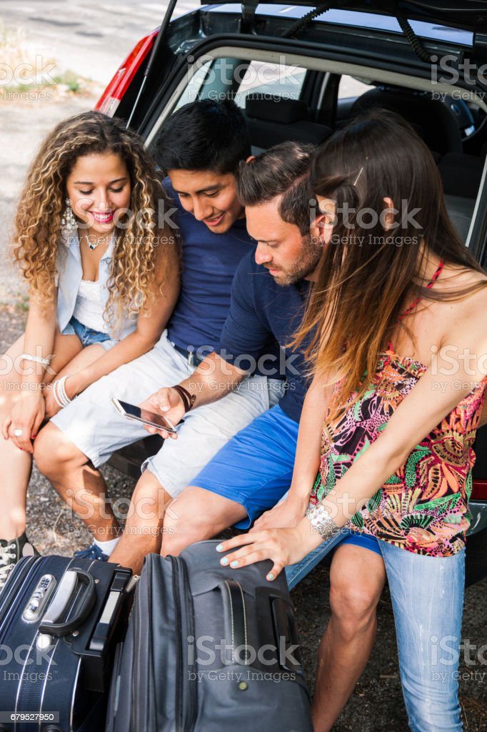 Friends loading the car to start a great vacation together royalty-free stock photo