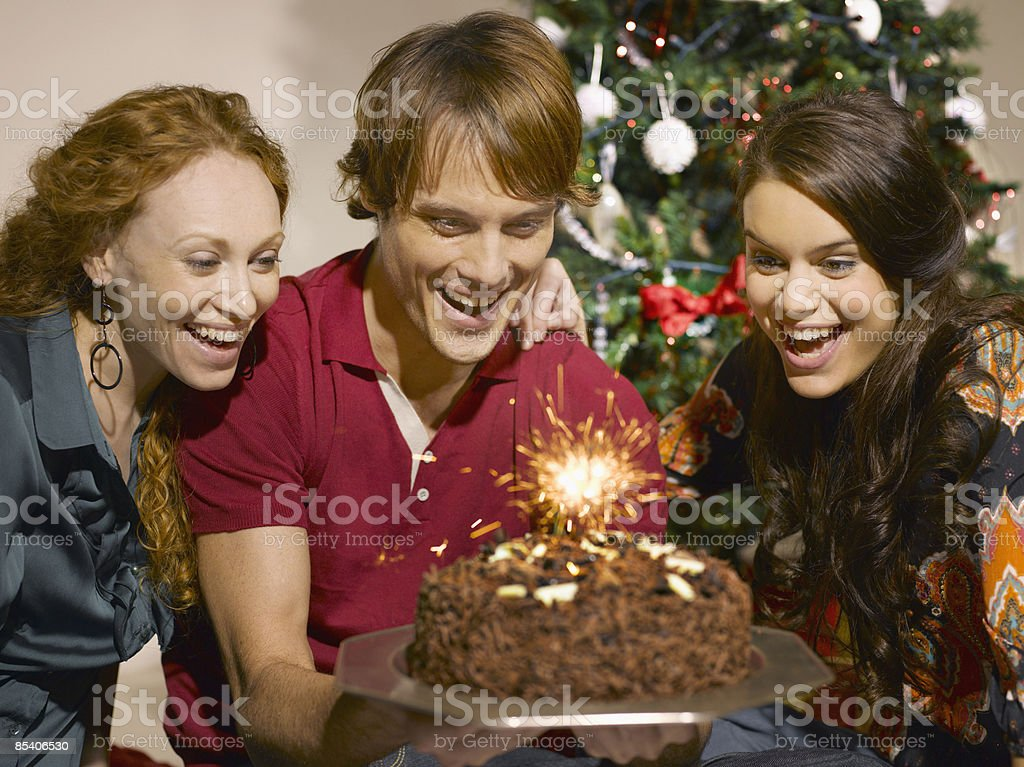 Friends looking at birthday cake royalty-free stock photo