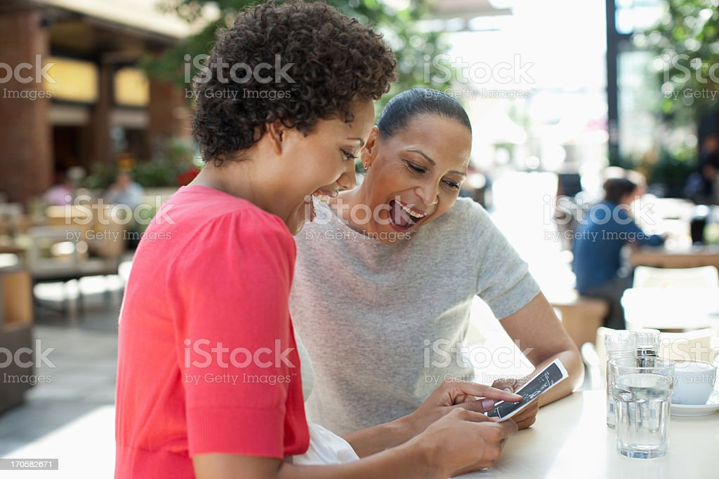 Friends looking at pregnancy sonogram image royalty-free stock photo