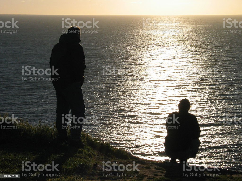 Friends looking over the ocean royalty-free stock photo
