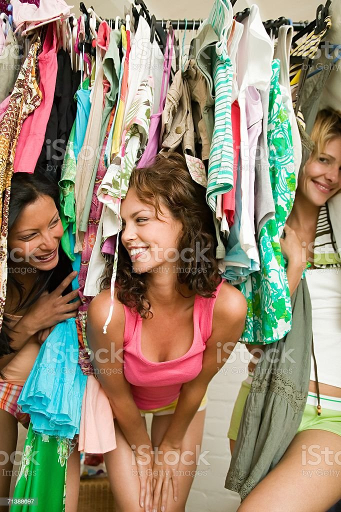 Friends looking through clothes royalty-free stock photo