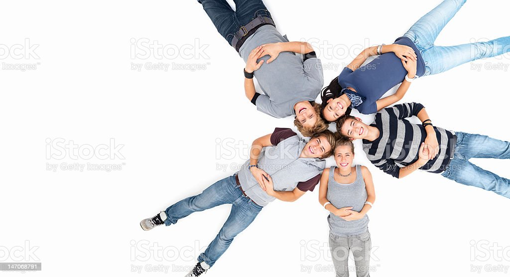 Friends lying together on white floor royalty-free stock photo