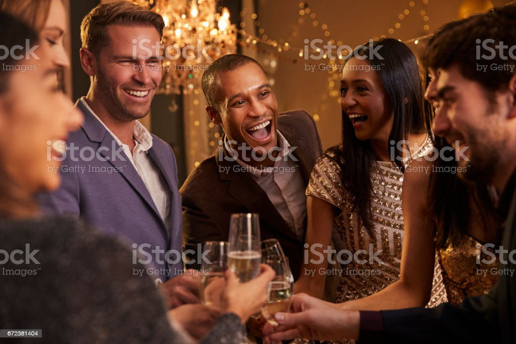 Friends Make Toast As They Celebrate At Party Together stock photo