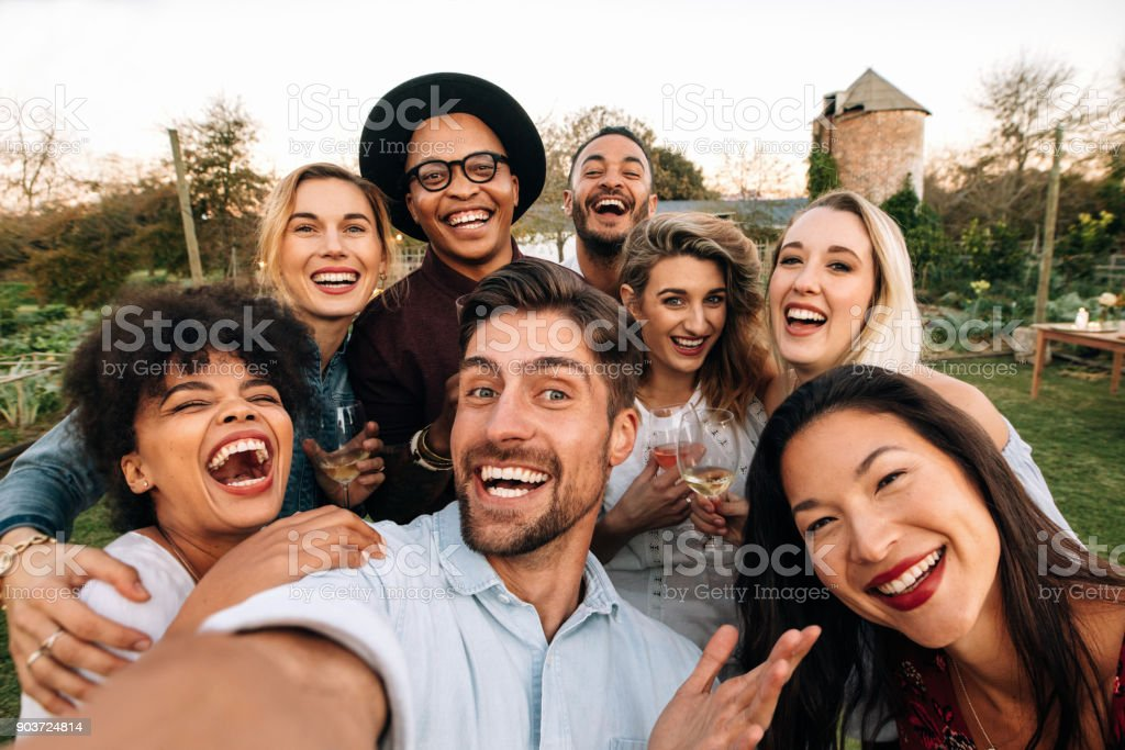 Friends making a selfie together at party stock photo