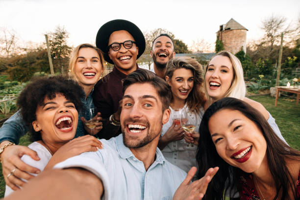 friends making a selfie together at party - party social event stock pictures, royalty-free photos & images