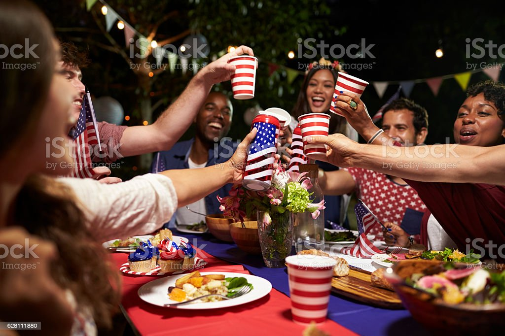 Friends Making A Toast To Celebrate 4th Of July Holiday stock photo