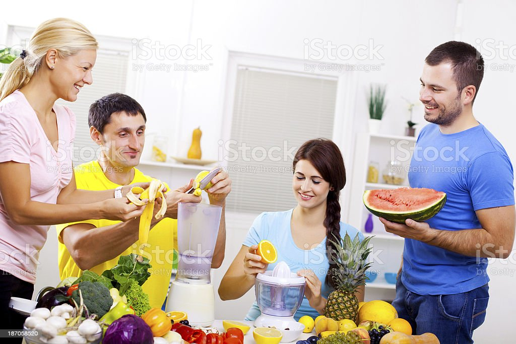 Friends making healthy juice. royalty-free stock photo
