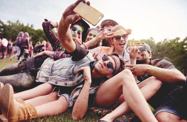 Friends making selfie at the summer festival stock photo