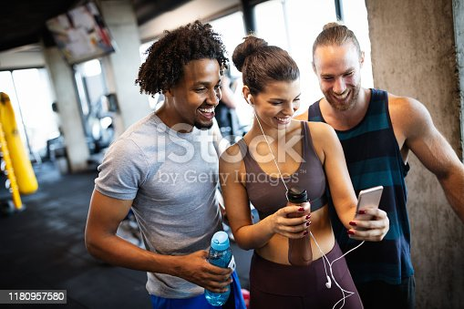 Friends making selfie in the gym after exercise