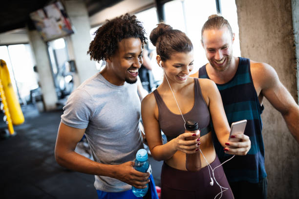 Friends making selfie in the gym after workout stock photo