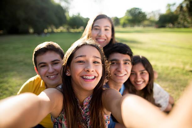 Friends making selfie stock photo