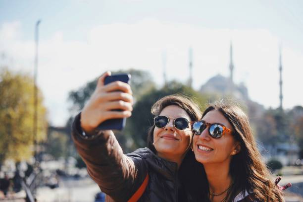 Friends Making Selfies in historical area of Istanbul stock photo