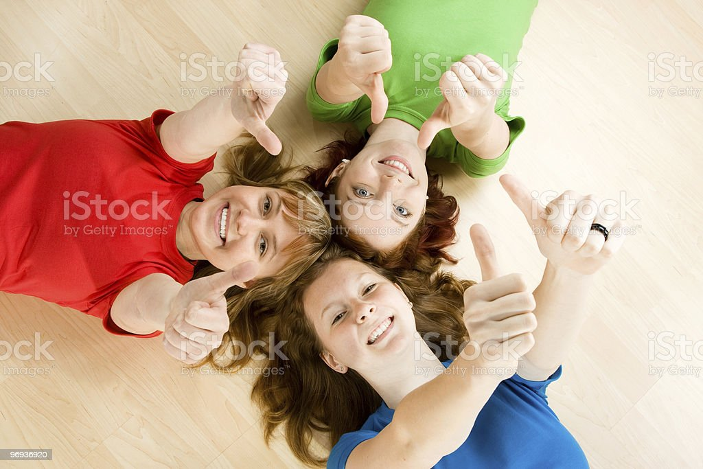 Friends making thumbs up sign royalty-free stock photo