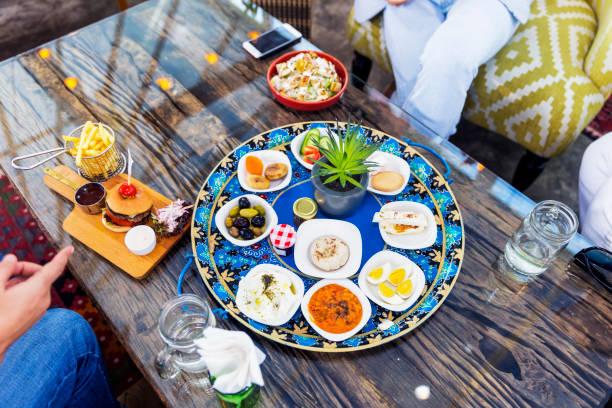friends meeting at cafe over a meal - abu dhabi стоковые фото и изображения
