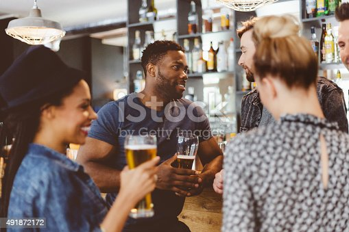 istock Friends meeting in a pub, drinking beer 491872172