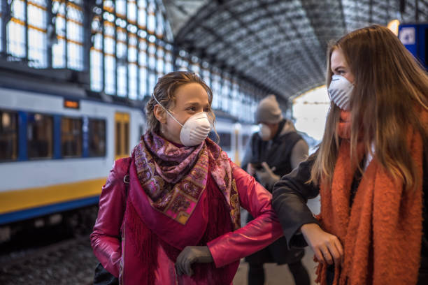 Friends meeting in public during virus outbreak stock photo
