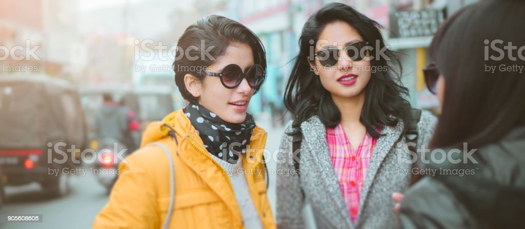 Friends meeting together on their way to office and home. stock photo