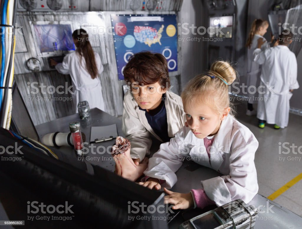 Friends of children are concentrating on finding a way out of mysterious bunker stock photo